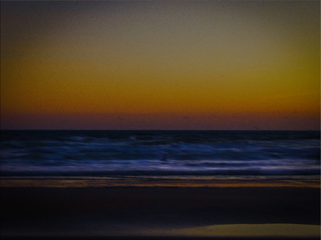 Photo edit of early morning sunrise over the Atlantic Ocean in Daytona Beach Shores Florida at the end of January. This photograph taken very early before the sun could pop out from the horizon, worked with this edit to give it a soft focus not sharp but