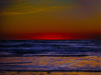 New Photo Art Titled: Red Sun Rising Over Troubled Seas. Photo Manipulation to produce a very red sun giving dark rich colors in the sky and the shoreline, while the Atlantic Ocean churns the surf.