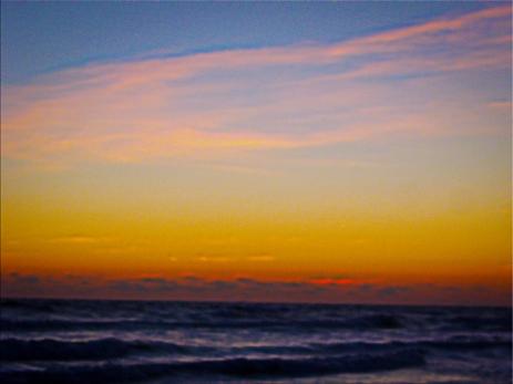 New Photo Art Titled: Day Brakes Over the Atlantic Ocean. Sunrise photograph taken just before the sun brakes over the horizon, on Daytona Beach, of the Atlantic Ocean and the morning sky.