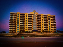 New Art Titled: Ocean Vistas Condominium From Daytona Beach.Photo Art Edit of photo taken at sunrise on the beach, of the Ocean Vistas. A private condominium