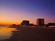 New Art Titled: Daytona Beach Shores From East to West on Beach. Photo art edit of photograph taken just before the sun comes up over the Atlantic Avenue on the Beach in Daytona Beach Shores.