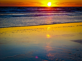 New Art Titled: Sunrise over Ocean & Reflected on Beach. Very unique sunrise image with the sun completely over the Atlantic coastal horizon and reflecting over the ocean, waves and beach, in a rainbow of vibrate colors.