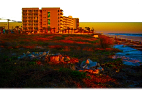 New Art Release Titled; Coastal Landscape and Beach Resort Art. Digital art edit of coastal landscape including a undeveloped lot by between the public access to Daytona Beach, the beach, the ocean a couple of beach resorts and the main street pier in th