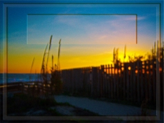 New Art Release Titled; Ocean Sunrise Through Wooden Fence And Sea Oats. Picture, Photo Art, Photo Frame All in One. Photo edit of morning sunrise on a beautiful day, as seen through a wooden fence