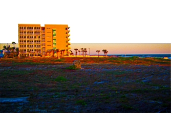 New Art Release Titled; Vacant Lot Next To Beach and Resort At Sunrise. Digital photo edit of vacant lot along the coast by a the Holiday Inn Beach Resort in Daytona Beach and the public access.